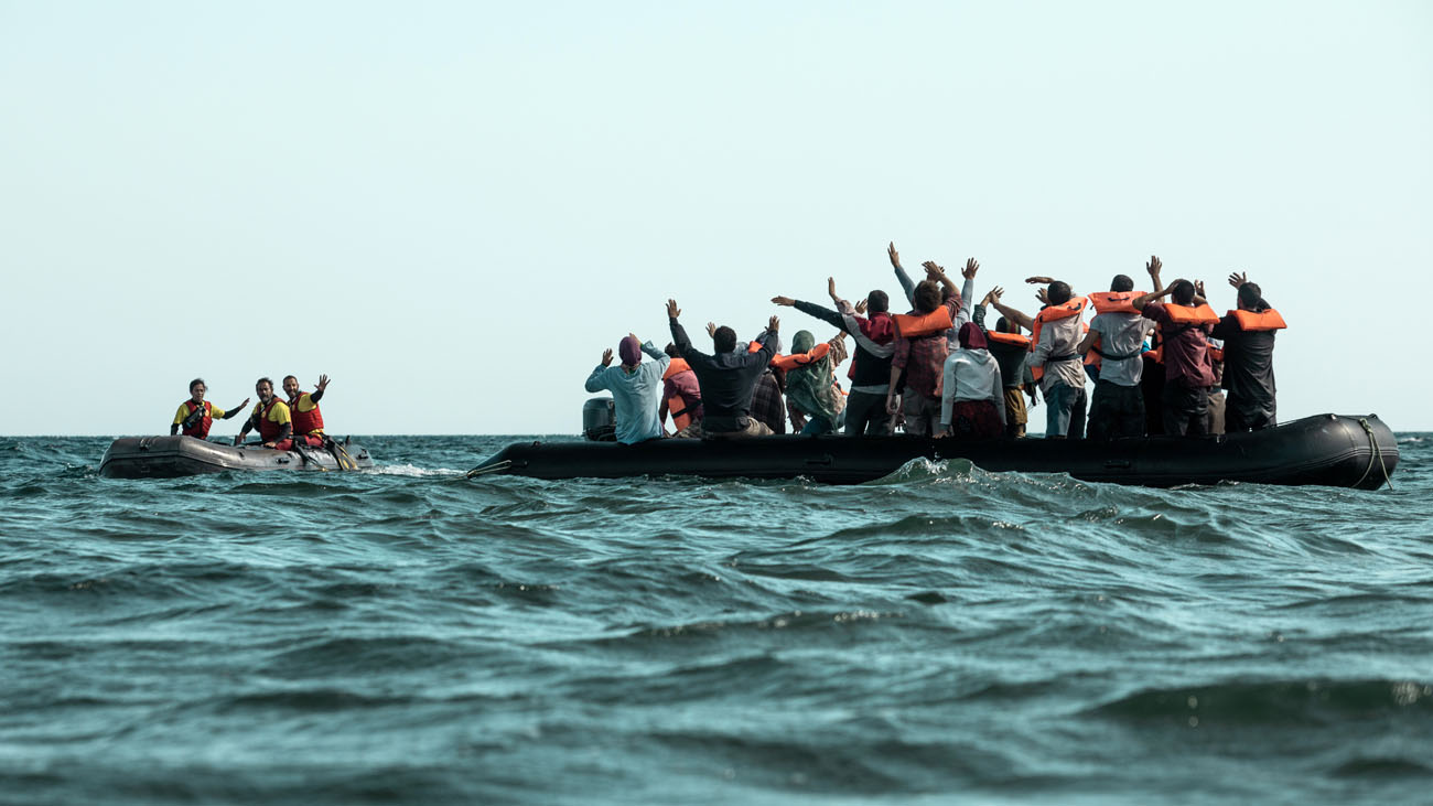 Refugees in the water. Photography by Lucia Faraig