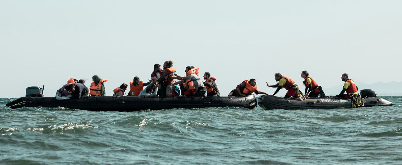 Refugees drifting in the mediterranean with the rescue team of Open Arms