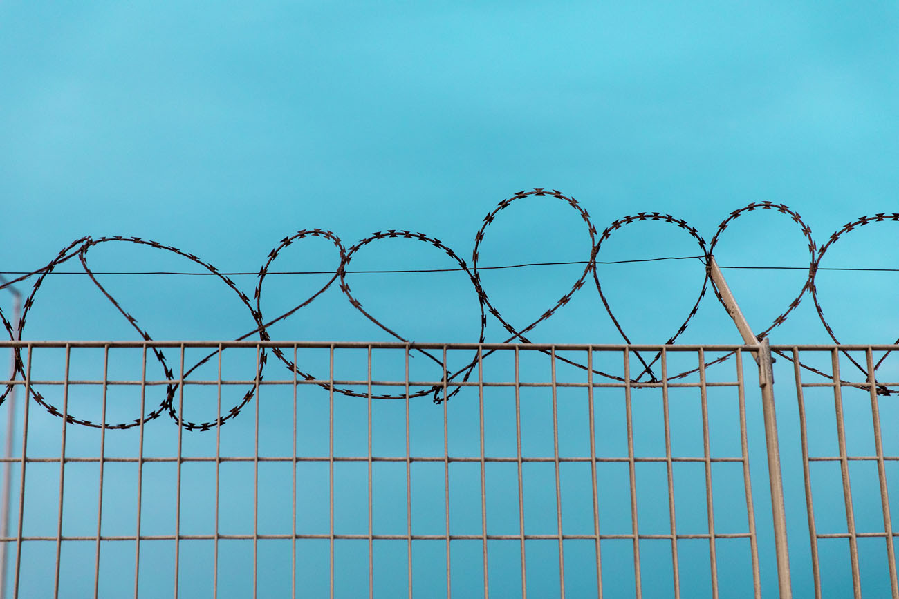 barbed wire fence in a refugee camp in Greece