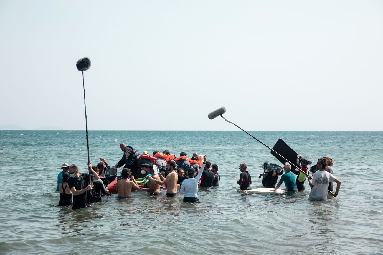 Filming team on the water